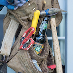 Beer in a carpenter's tool belt